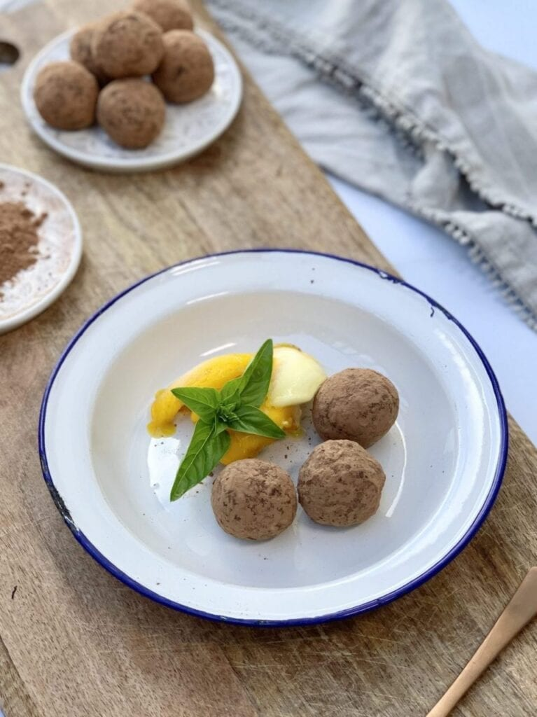 the finished salted caramel energy balls served on a wooden board with sorbet