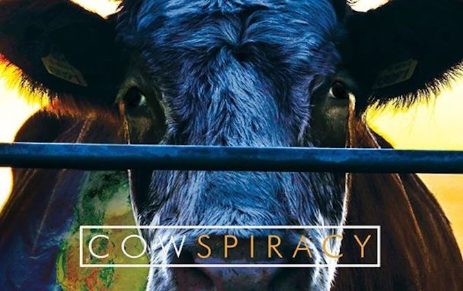 The promotional image for one of the vegan documentaries; Cowspiracy. Showing a cow behind a metal railing behind the title writing.