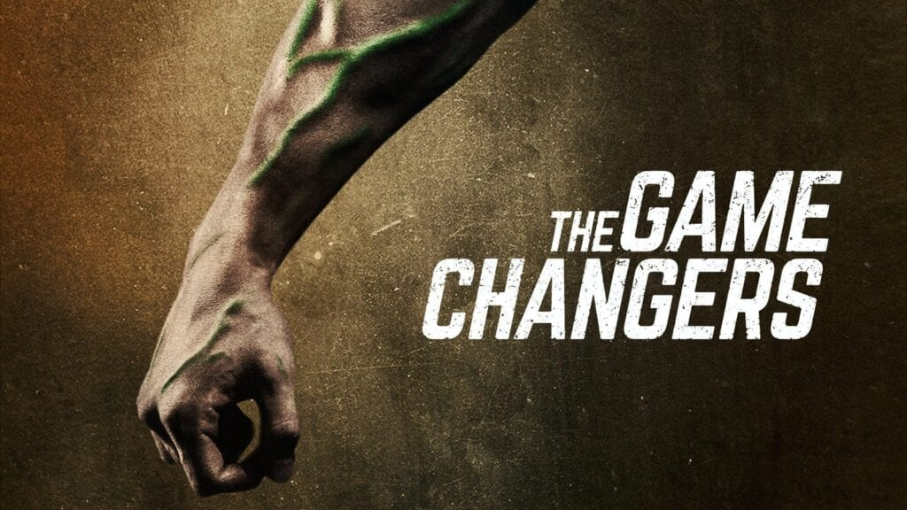 The promotional image for The Game Changers. Showing a mans muscular forearm with green veins next to the title.