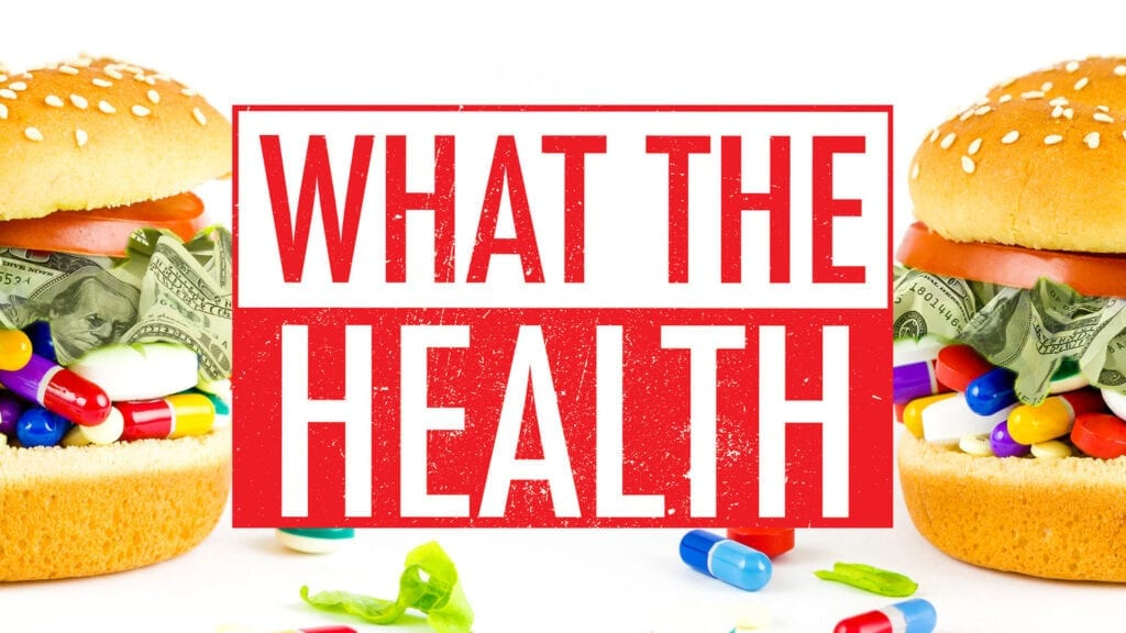 The promotional image for What the Health. Showing the title text between two burger buns filled with pills and American paper money