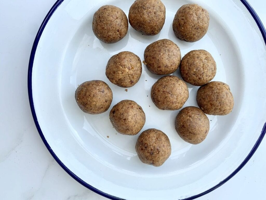 a plate with the rolled balls on a white background