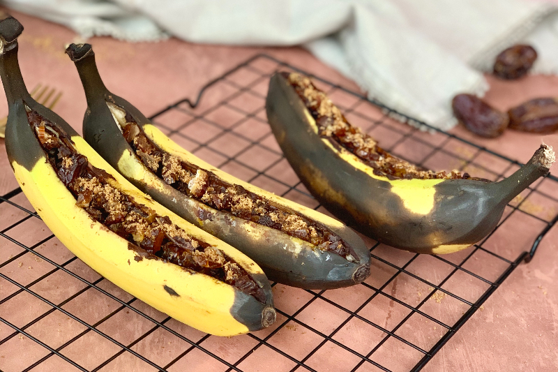 baked bananas cooling on a black wire rack
