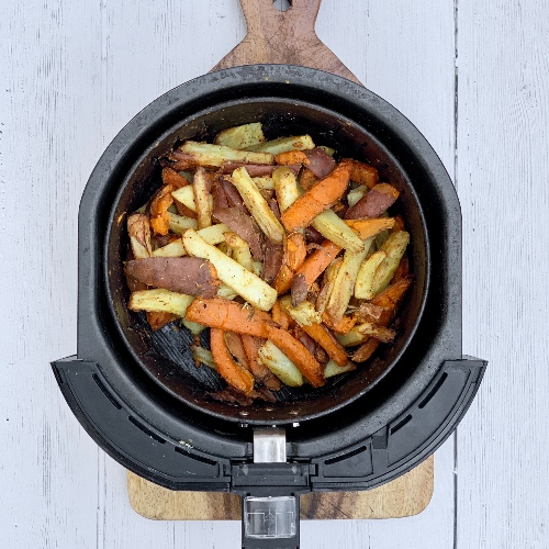 crispy cooked potatoes in the air fryer bowl