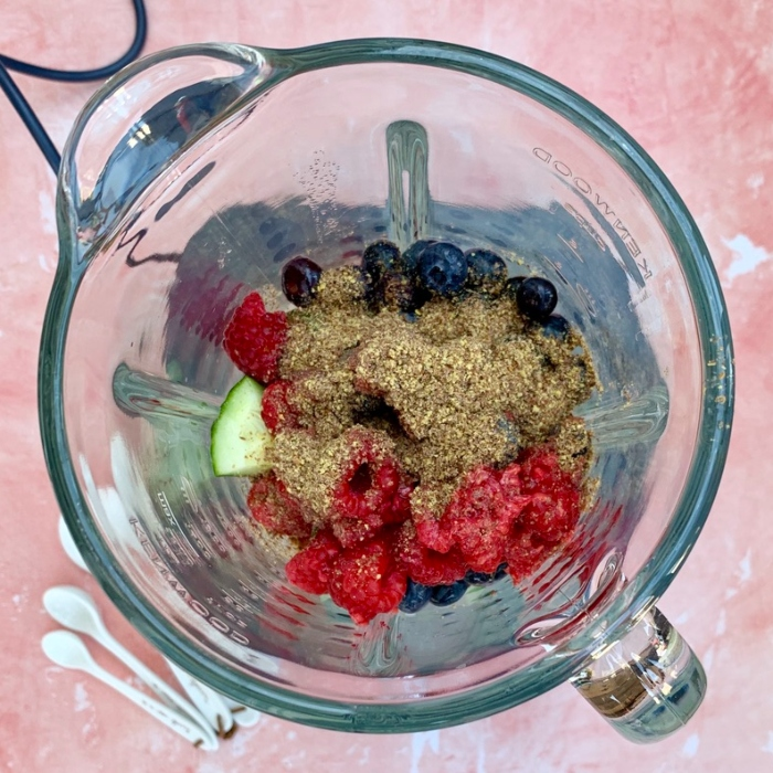 all of the ingredients for the berry smoothie recipe in a blender