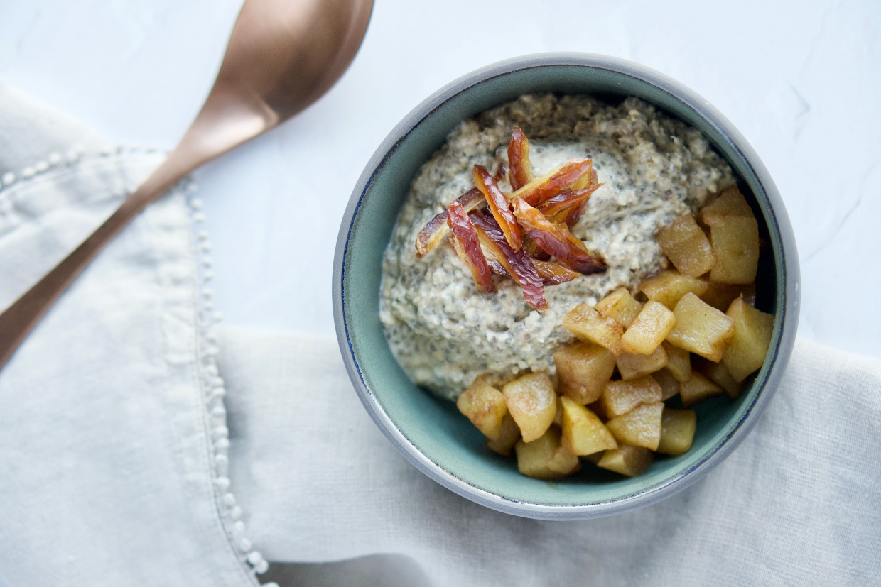 a finished bowl of the apple cinnamon overnight oats with chopped date on top of the oats and chia seeds