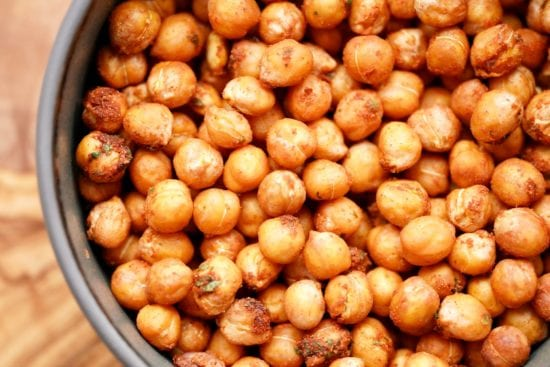 a close up detaild view of the finished air fryer chickpea recipe in a grey bowl