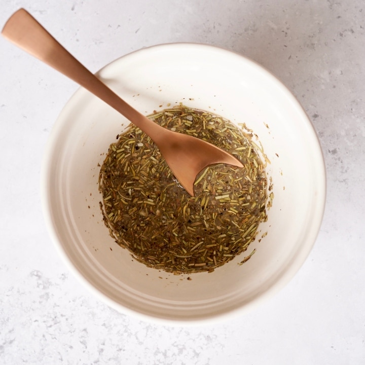 milk, balsamic vinegar herb mix in a bowl with a spoon