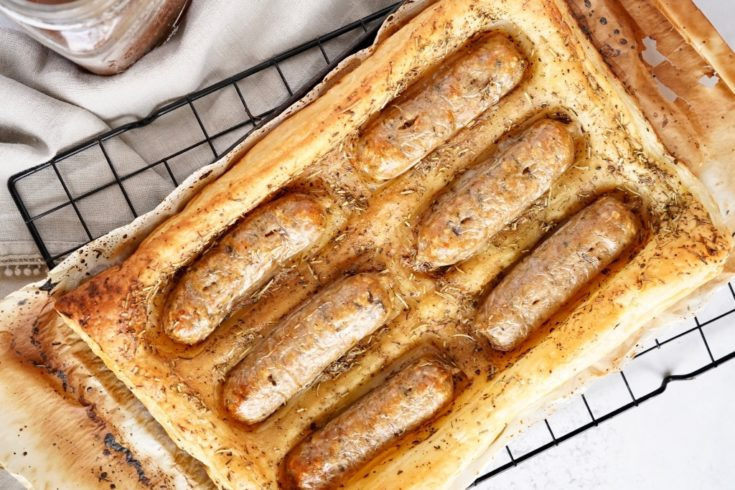 vegan toad in the hole in a baking tray on a wire cooling rack