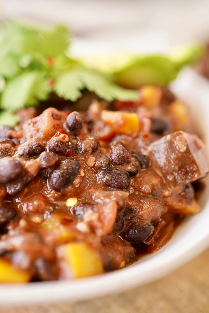 a close up of the vegan black bean chili in a bowl