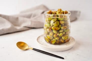 edamame snack recipe beans in a jar next to a spoon