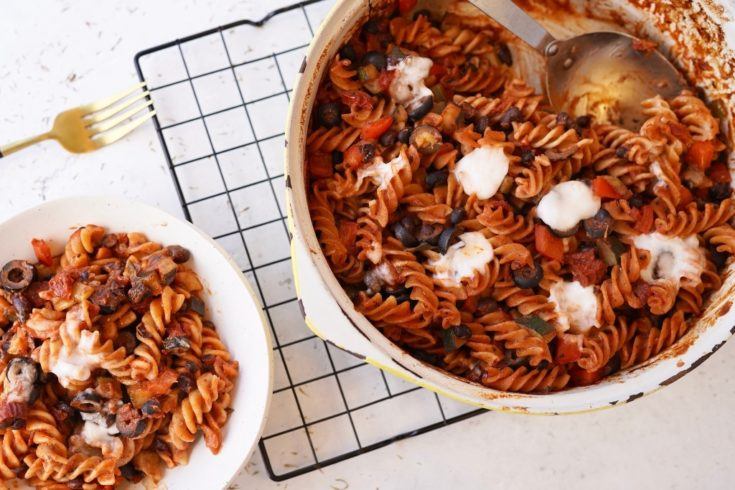 vegan pasta bake in a dish with a portion next to it in a bowl