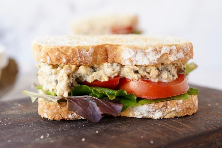 chickpea tuna salad in a sandwich with lettuce and tomato